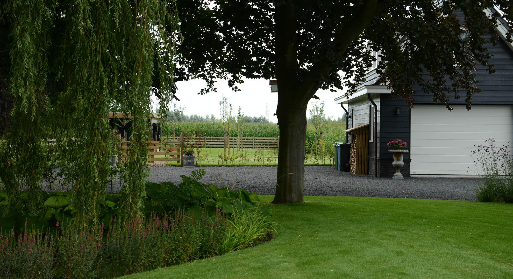 Landelijke tuin bij modern landhuis - Foto 6