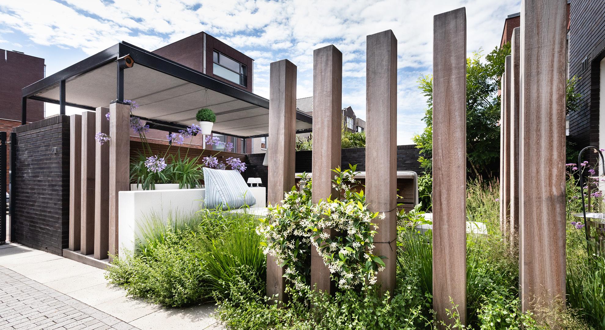 Moderne onderhoudsvriendelijke tuin met buitenkeuken - Foto 6
