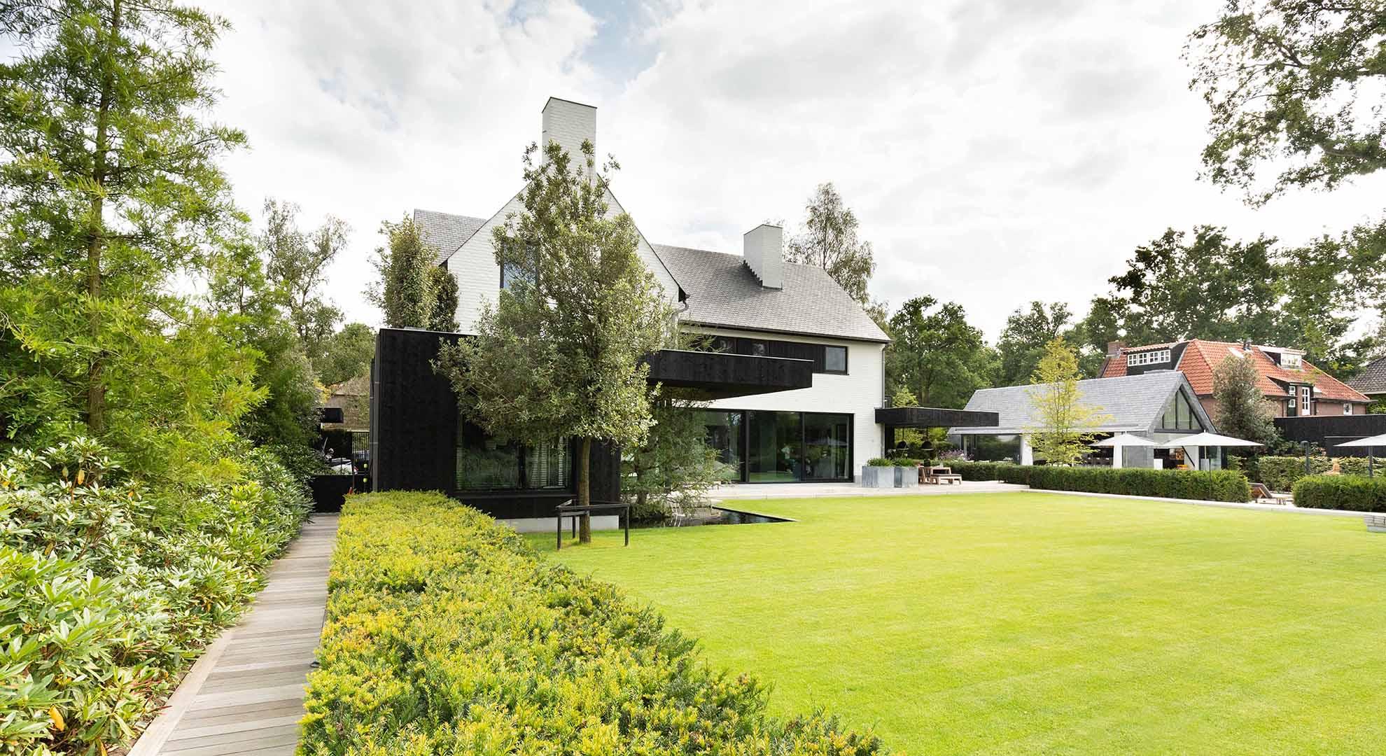 Moderne tuin met zwembad en bijzonder terras - Foto 10