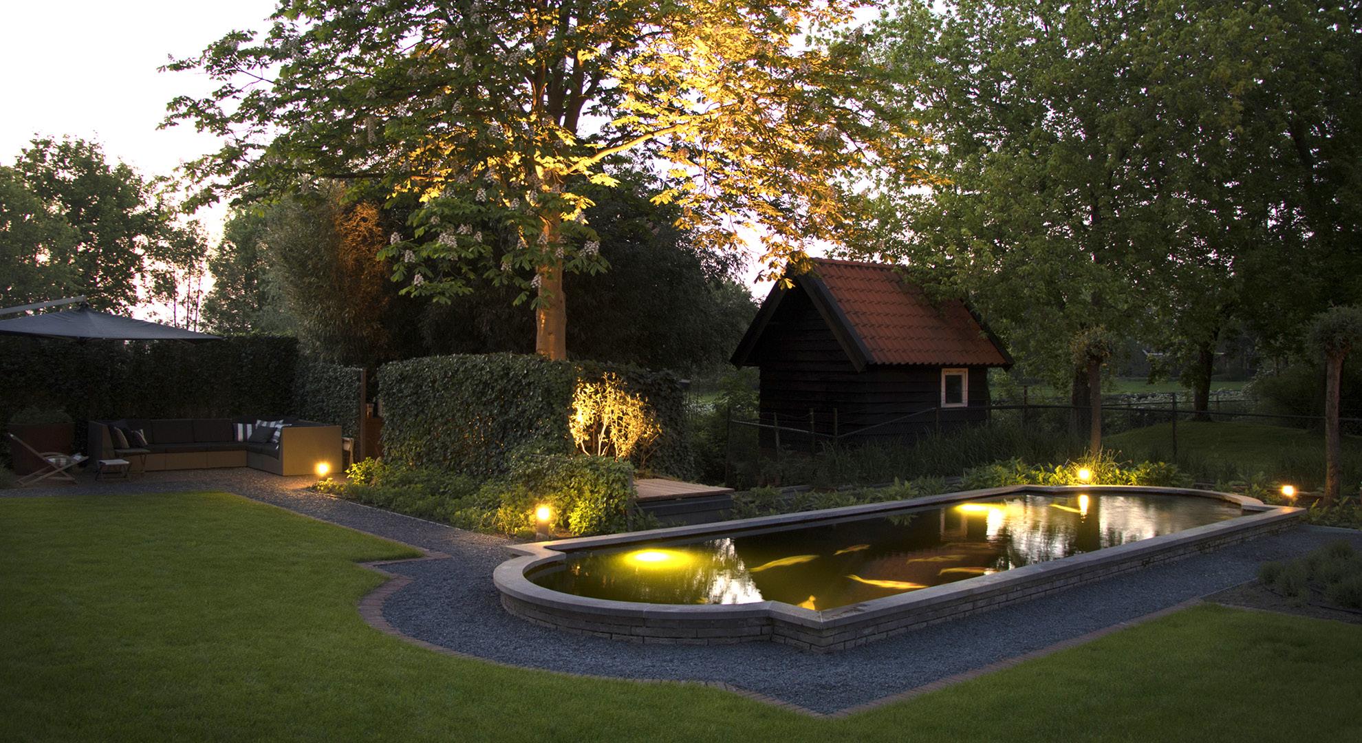 Natuurlijke tuin bij een statige woning aan het water - Foto 6