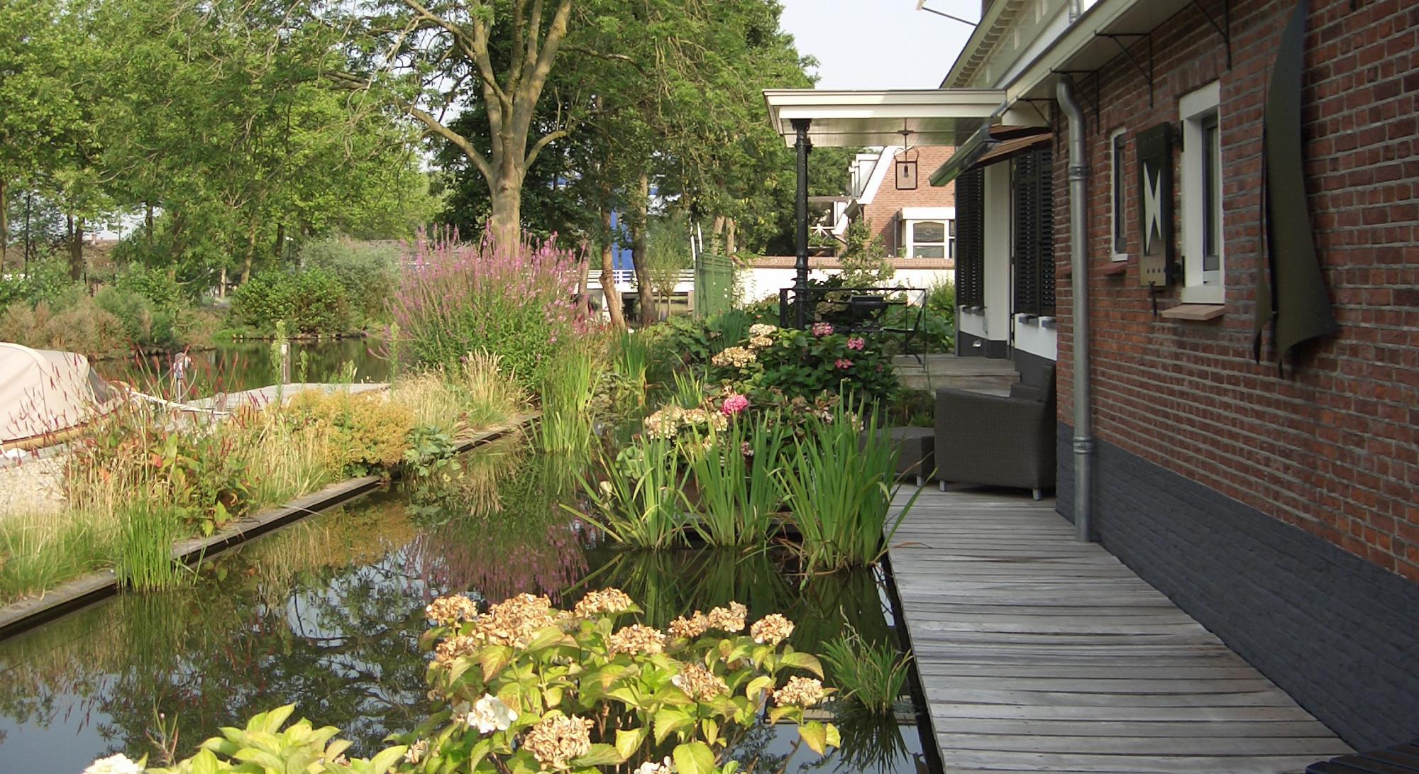 Natuurlijke tuin met aansluiting op de Oude Rijn - Foto 2