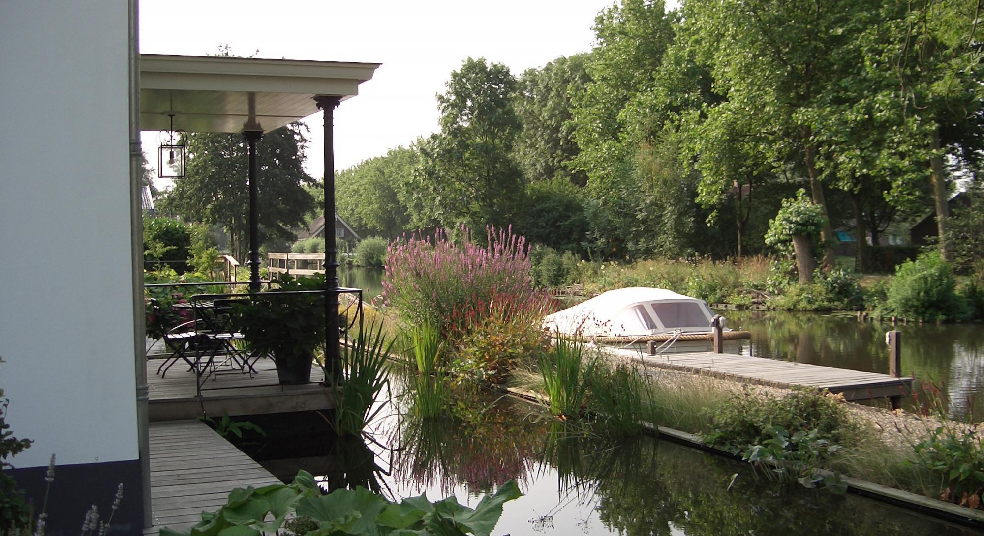 Natuurlijke tuin met aansluiting op de Oude Rijn - Foto 6