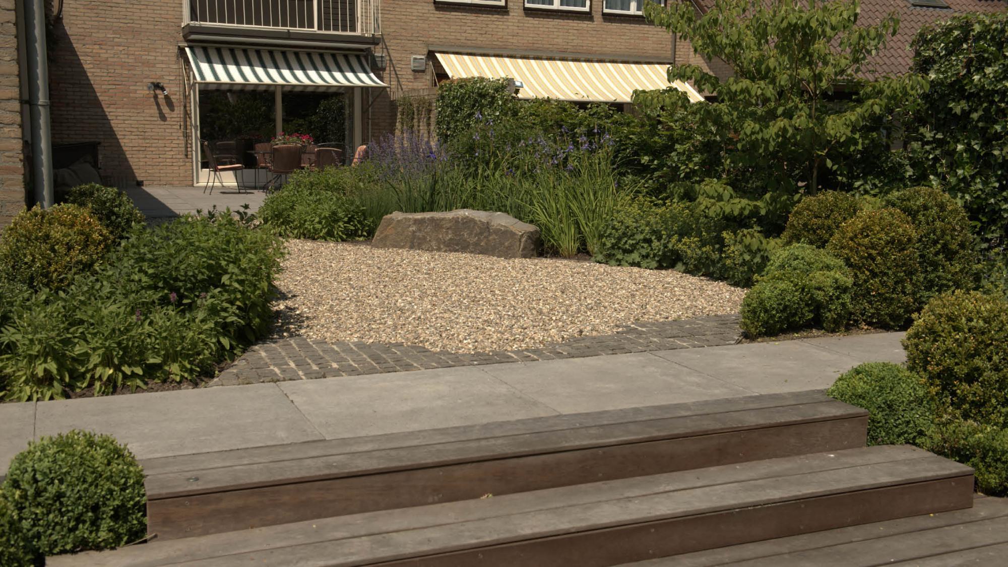 Natuurlijke tuin rondom een hoekwoning - Foto 5